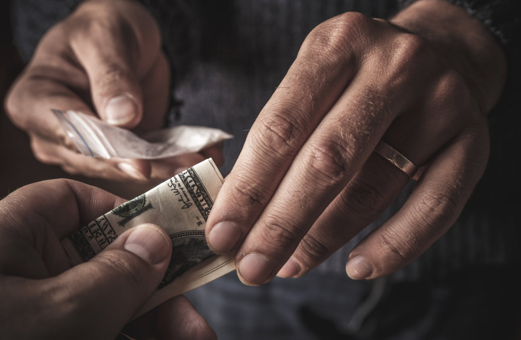 crop image of a man buying drug to a dealer